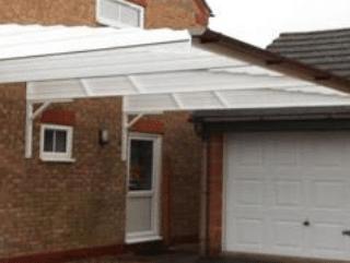 White carport by garage doors norfolk