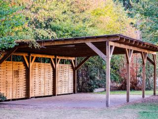 wooden carport by garage doors norfolk